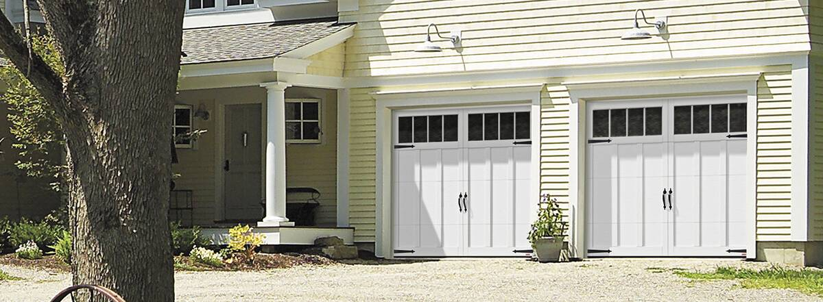 Eastman E-13, 9' x 7', Ice White doors and overlays, 4 vertical lite Orion windows